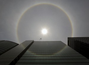 A plane flies past a solar halo in Mexico City May 21, 2015. According to meteorologists, the weather phenomenon creates rainbows around the sun and is formed by the reflection of ice crystals. REUTERS/Henry Romero TPX IMAGES OF THE DAY