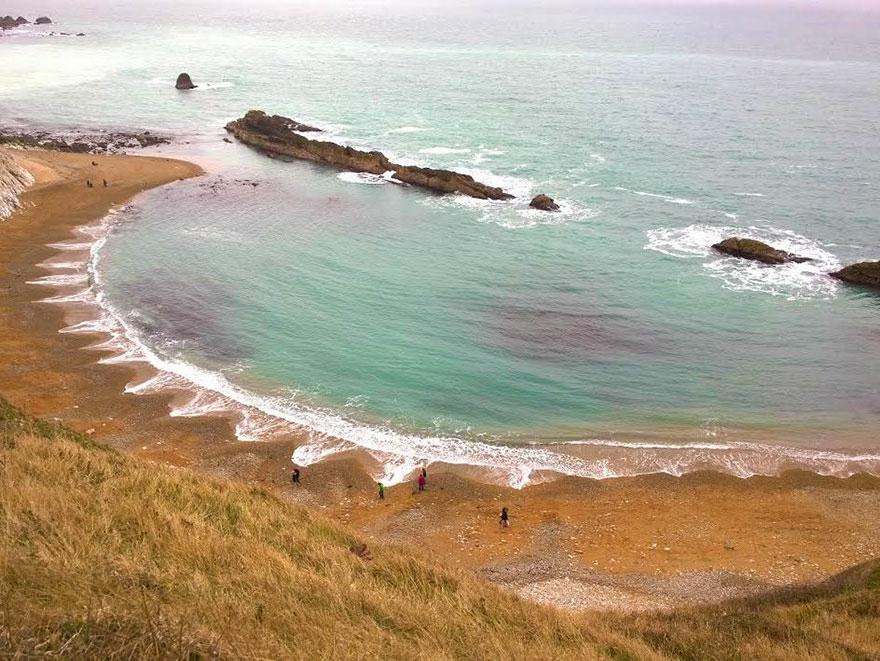 cuspides-playa-formaciones-arena-olas-2