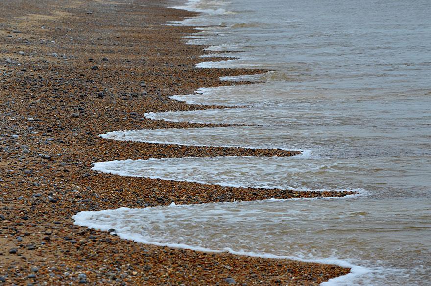 cuspides-playa-formaciones-arena-olas-4