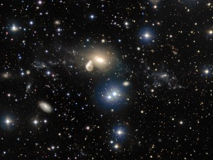 The spectacular aftermath of a 360 million year old cosmic collision is revealed in great detail in this image from ESO's Very Large Telescope at the Paranal Observatory. Among the debris surrounding the elliptical galaxy NGC 5291 at the centre is a rare and mysterious young dwarf galaxy, which appears as a bright clump towards the right of the image. This object is providing astronomers with an excellent opportunity to learn more about similar galaxies that are expected to be common in the early Universe, but are normally too faint and distant to be observed by current telescopes.