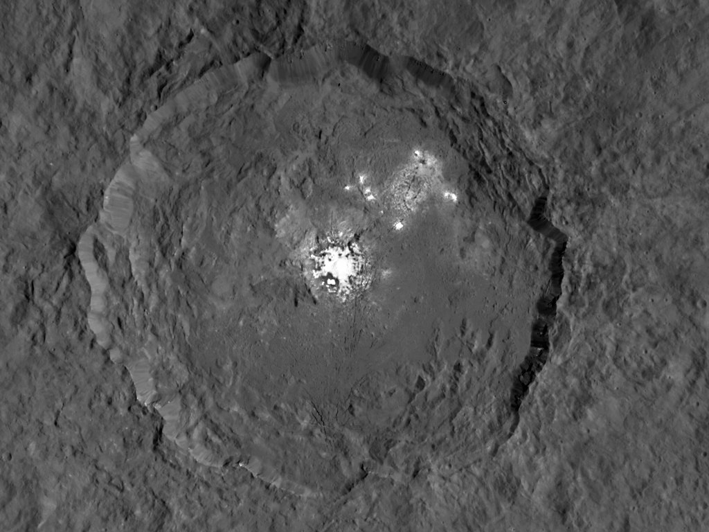 This image taken from NASA's Dawn spacecraft in orbit around the dwarf planet Ceres shows the very bright patches of material in the crater Occator and elsewhere. New observations using the HARPS spectrograph on the ESO 3.6-metre telescope at La Silla in Chile have revealed unexpected daily changes on these spots, suggesting that they change under the influence of sunlight.