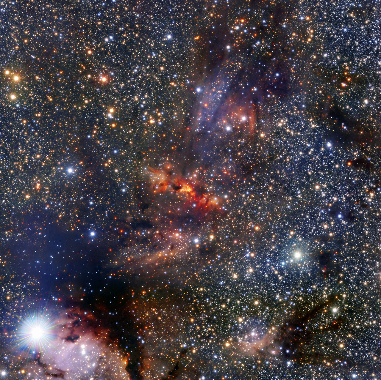 This image shows a region of the Milky Way that lies within the constellation of Scorpius, close to the central plane of the galaxy. The region hosts a dense cloud of dust and gas associated with the molecular cloudIRAS 16562-3959, clearly visible as an orange smudge among the rich pool of stars at the centre of the image. Clouds like these are breeding grounds for new stars. In the centre of this cloud the bright object known as G345.4938+01.4677 can just be seen beyond the veil of gas and dust. This is a very young star in the process of forming as the cloud collapses under gravity. The young star is very bright and heavy — roughly 15 times more massive than the Sun — and featured in a recent Atacama Large Millimeter/submillimeter Array (ALMA) result. The team of astronomers made surprising discoveries within G345.4938+01.4677 — there is a large disc of gas and dust around the forming star as well as a stream of material flowing out from it. Theories predict that neither such a stream, nor the disc itself, are likely to exist around stars like G345.4938+01.4677 because the strong radiation from such massive new stars is thought to push material away. This image was made using the Visible and Infrared Survey Telescope for Astronomy (VISTA), which is part of ESO's Paranal Observatory in the Atacama Desert of Chile. It is the world's largest survey telescope, with a main mirror that measures over four metres across. The colour image was produced by the VVV survey, which is one of six large public surveys that are devoted to mapping the southern sky. The bright star in the bottom left of the image is known as HD 153220.