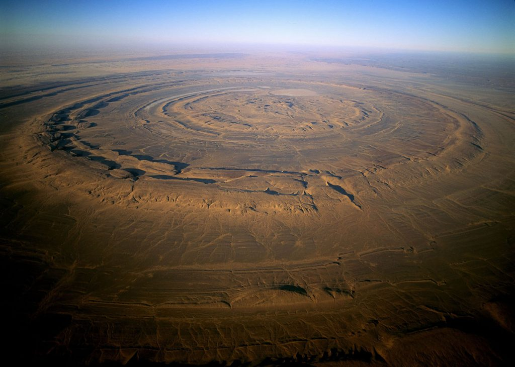 01 Apr 1997, Mauritania --- The Richat Structure of Guelb er Richat in Mauritania. This strange volcanic structure is a landmark seen by astronauts as they pass over the Sahara. Originally thought to be a meteorite impact, it is now known to be a volcanic bulge that never erupted and was leveled by erosion. --- Image by © George Steinmetz/Corbis