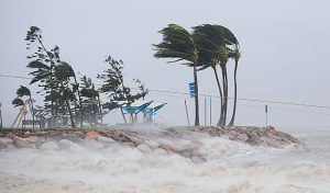 TOWNSVILLE, AUSTRALIA - FEBRUARY 03: Strong winds are seen hitting a section of the 'Strand' on February 3, 2011 in Townsville, Australia. So far no deaths or serious injuriees have been reported following Cyclone Yasi which struck land as a category five storm around midnight yesterday. The Queensland towns of Innisvail, Mission Beach, Tully and Cardwell where hit hardest by Yasi with authorities waiting for safer conditions to assess the full extent of the damage. Yasi has been downgraded to a category two storm as it passes inland. (Photo by Ian Hitchcock/Getty Images)