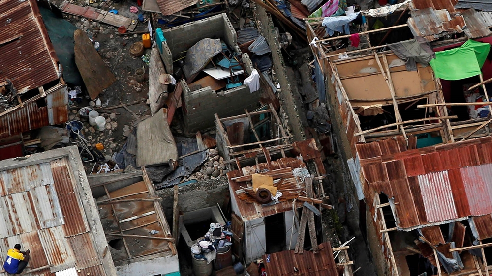 People try to rebuild their destroyed houses after Hurricane Matthew passes Jeremie, Haiti, October 6, 2016. REUTERS/Carlos Garcia Rawlins