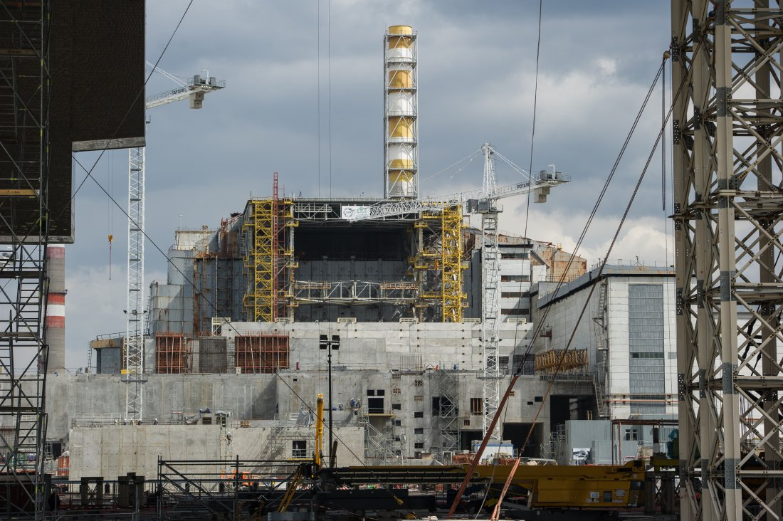 CHERNOBYL, UKRAINE - APRIL 22: The fourth reactor of the Chernobyl Nuclear Power Plant is seen through the New Safe Confinement in Chernobyl, Ukraine, April 22, 2016. The world will mark the thirtieth anniversary of the Chernobyl nuclear disaster on April 26, 2016. (Photo by Alexey Furman/Anadolu Agency/Getty Images)